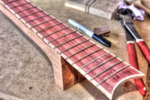 25 Simple Ways to Customize Your Guitar Without Changing the Tone binding the fretboard