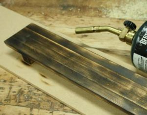 23-easy-ways-to-age-wood-and-make-wood-look-old-toasting-wood-with-fire