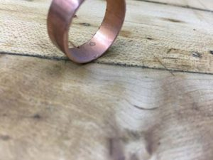 how-to-make-a-wood-and-copper-ring-from-a-pipe-fitting-with-the-wood-on-the-inside-5