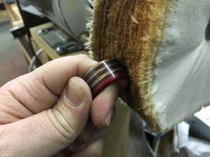 how-to-make-a-wood-ring-with-a-metal-band-buffing-the-finished-ring-on-the-buffing-setup