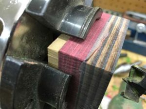 how-to-make-a-wood-ring-with-a-metal-band-drilling-with-a-scrap-backer-on-the-lathe