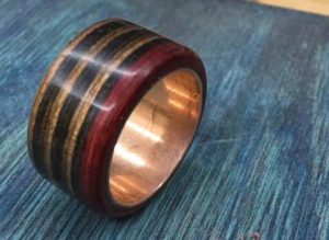 how-to-make-a-wood-ring-with-a-metal-band-finishing-by-hand-with-oil