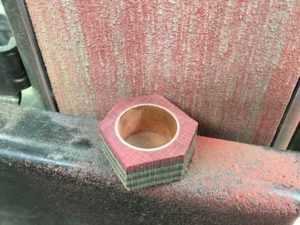 how-to-make-a-wood-ring-with-a-metal-band-rounding-the-shape-of-the-blank-on-the-belt-sander