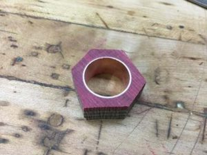 how-to-make-a-wood-ring-with-a-metal-band-sawing-off-the-excess-waste