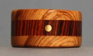 25-Things-I-Wish-I-Knew-When-I-Started-Making-Wooden-Rings-cocobolo-and-olivewood-ring-with-a-brass-dot-inlay