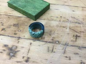 How-to-Make-a-Wood-and-Epoxy-Ring-with-Inlace-Nuggets-finished-ring-flat