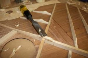 How-to-Make-an-Acoustic-Guitar-Series---Part-Five---Carving-the-Top-Braces-carving-the-legs-of-the-x-brace