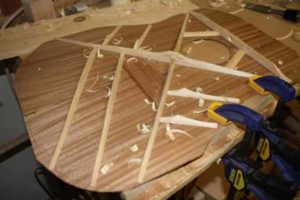 How-to-Make-an-Acoustic-Guitar-Series---Part-Five---Carving-the-Top-Braces-clamping-down-the-guitar-top-for-carving