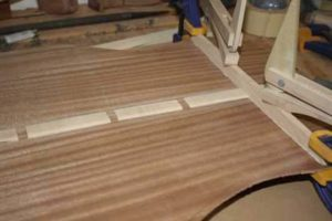 How-to-Make-an-Acoustic-Guitar-Series---Part-Six---Bracing-the-Back-clamping-curved-braces-to-the-top