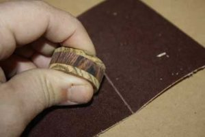 The-Ultimate-Guide-to-Sandpaper-Grits-80-grit-sanding-a-ring-blank