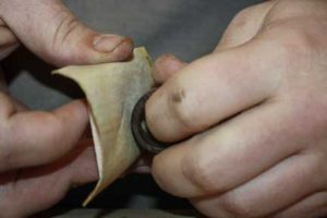 11-Easy-Tips-on-How-to-Texture-Your-Wooden-Rings-sanding-the-ring-to-remove-rough-spots