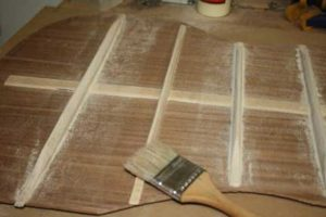How-to-Make-an-Acoustic-Guitar-Series---Part-Seven---Carving-the-Back-Braces-brushing-off-the-sanding-dust