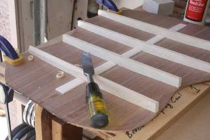 How-to-Make-an-Acoustic-Guitar-Series---Part-Seven---Carving-the-Back-Braces-clamping-down-the-back-plate