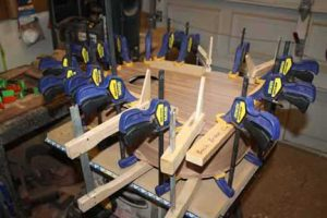 How-to-Make-an-Acoustic-Guitar-Series---Part-Thirteen---Attaching-the-Top-Plate-lots-of-clamps-on-the-top