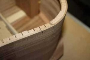 How-to-Make-an-Acoustic-Guitar-Series---Part-Thirteen---Attaching-the-Top-Plate-notching-the-lerfing