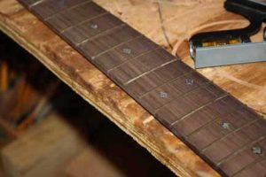 How-to-Make-an-Acoustic-Guitar-Series-Part-Twenty-Five-Fretting-frets-on-the-fretboard