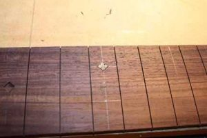 How-to-Make-an-Acoustic-Guitar-Series-Part-Twenty-Four-Fretboard-Inlay-adding-the-inlay-piece