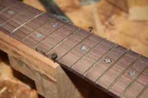How-to-Make-an-Acoustic-Guitar-Series-Part-Twenty-Six-Attaching-the-Fretboard-carpet-tacks-at-the-14th-fret