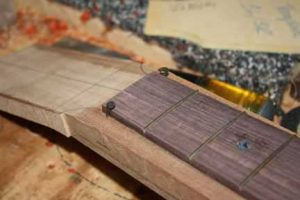 How-to-Make-an-Acoustic-Guitar-Series-Part-Twenty-Six-Attaching-the-Fretboard-carpet-tacks-at-the-nut